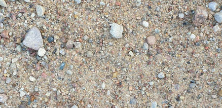 Closeup of gravel road ground. With stones Stock Photo