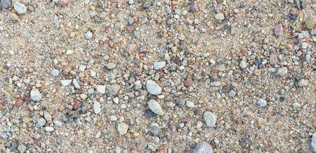 Closeup of gravel road ground. With stones 写真素材