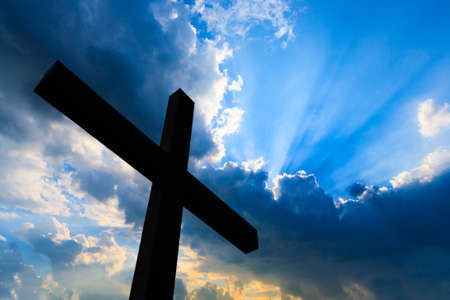 bible and cross: Cross silhouette and the holy blue sky