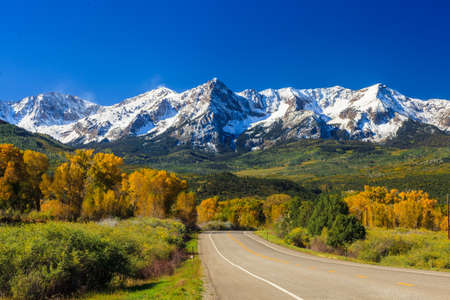 Countryside road, fall season in Colorado photo