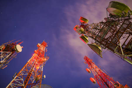 Group of Telecommunication towers at night photo