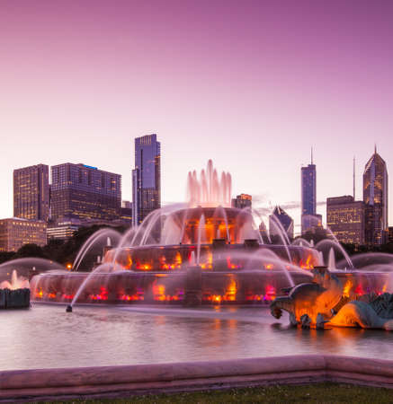 Chicago skyline panorama with skyscrapers and Buckingham fountain at twilight  photo