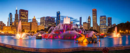 fountains: Chicago skyline panorama with skyscrapers and Buckingham fountain at twilight