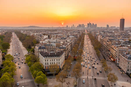 The famous Champs-Elysées in Paris from the top of the Arc De Triomphe at night  photo