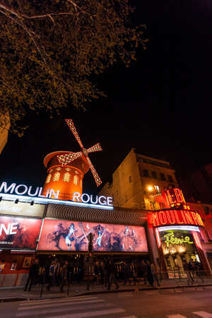 scandalous: PARIS - June 25  The Moulin Rouge at night, on June 25, 2013 in Paris, France  Moulin Rouge is a famous cabaret built in 1889,  locating in the Paris red-light district of Pigalle