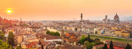 Florence city during sunset. Panoramic view to the river Arno, with Ponte Vecchio, Palazzo Vecchio and Cathedral of Santa Maria del Fiore (Duomo), Florence, Italy photo