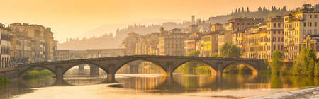 Florence, Ponte alla Carraia medieval Bridge landmark on Arno river, sunset panorama