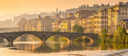 Florence, Ponte alla Carraia medieval Bridge landmark on Arno river, sunset panorama  photo