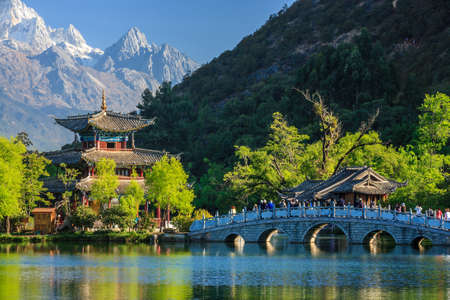 Lijiang old town scene-Black Dragon Pool Park. you can see Jade Dragon Snow Mountain in the background. Stock Photo