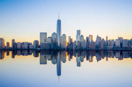 Manhattan Skyline with the One World Trade Center building at twilight, New York City Stock Photo