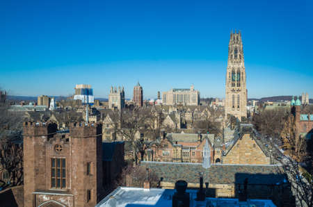 ivy league: Yale university buildings in winter sunlight with snow and blue sky Stock Photo