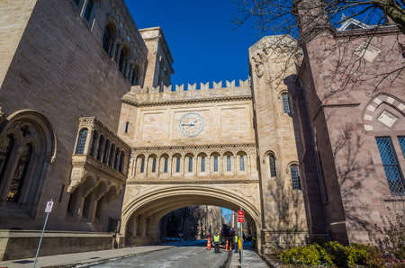 ivy league: Yale university buildings in winter sunlight with snow and blue sky Editorial