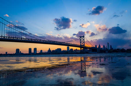ben franklin: Panorama of Philadelphia skyline, Ben Franklin Bridge and Penns Landing sunset Editorial