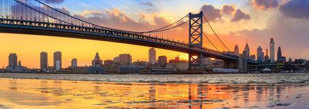 philadelphia: Panorama of Philadelphia skyline, Ben Franklin Bridge and Penns Landing sunset Editorial