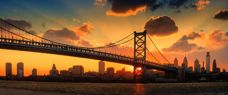 Panorama of Philadelphia skyline, Ben Franklin Bridge and Penns Landing sunset Editorial