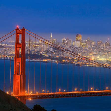 san: Golden Gate Bridge and downtown San Francisco at twilight