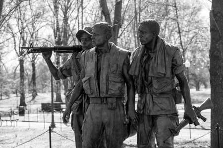 Vietnam Veterans Memorial Statue, Washington DC, USA in black and white