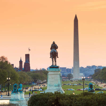Washington DC city view at a orange sunset, including Washington Monument from Capitol building