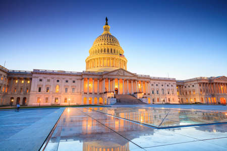 historic buildings: The United States Capitol building with the dome lit up at night.