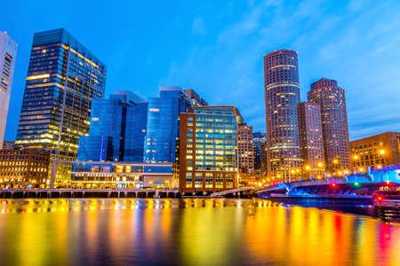 boston tea party: Boston Harbor and Financial District at twilight in Boston, Massachusetts. Stock Photo
