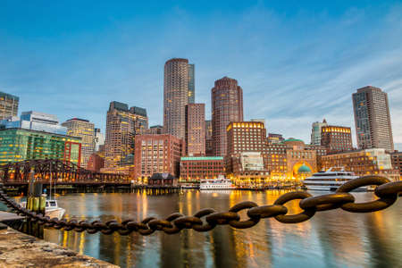 boston tea party: Boston Harbor and Financial District at twilight in Boston, Massachusetts. Stock Photo