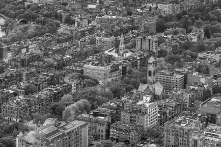 An aerial view of Boston cityscape in black and white photo