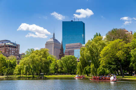 BOSTON, USA - MAY 20: Locals and tourists enjoying a ride on the famous swan boats at the Boston Public Garden in Boston, Massachusetts, USA on a sunny summer day of May 20, 2014.
