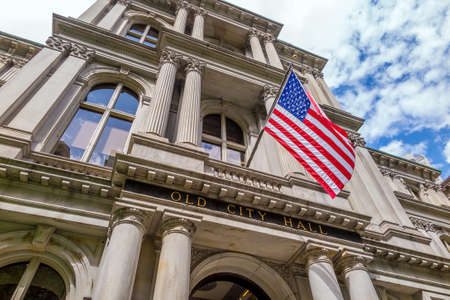 American flag on the Old City Hall building in Boston, Massachusetts, USA photo
