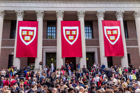 harvard university: CAMBRIDGE, MA - MAY 29: Students of Harvard University gather for their graduation ceremonies on Commencement Day on May 29, 2014 in Cambridge, MA.