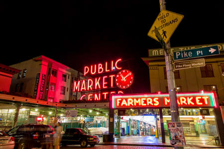 pike place market sign: SEATTLE - JULY 5: The Public Market Center also known worldwide as Pike Place Market at night in Seattle, Washington on July 5, 2014. Editorial