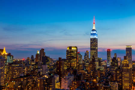empire state building: Beautiful New York City skyline with urban skyscrapers at sunset. Stock Photo