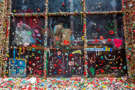 pike place: SEATTLE- JULY 5 : The Market Theater Gum Wall in downtown Seattle on July 5, 2014. It is a local landmark in downtown Seattle, in Post Alley under Pike Place Market.  Editorial