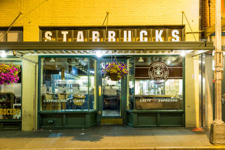 SEATTLE - JULY 5: Original Starbucks store at 1912 Pike Place on July 5, 2014 in Seattle. Serving coffe in 20.891 stores in 62 countries, Starbucks is worlds largest coffeehouse company.