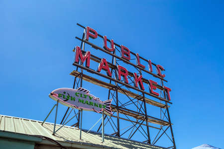 pike place market sign: SEATTLE - JULY 5: The Public Market Center also known worldwide as Pike Place Market in Seattle, Washington on July 5, 2014.