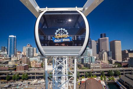 elliot: SEATTLE - JULY 5:  The Seattle Great Wheel on July 5, 2014. The Seattle Great Wheel opened to the public on June 29, 2012