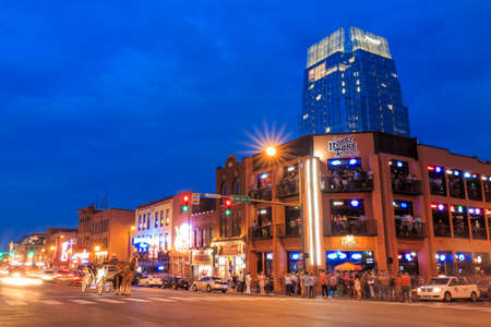 tn: NASHVILLE - AUGUST 1: Downtown Nashville cityscape in the evening on August 1, 2014 in Nashville, TN. Nashville is the capital of the State of Tennessee and the county seat of Davidson County. Editorial