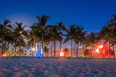 miami sunset: Miami Beach, Florida hotels and restaurants at twilight on Ocean Drive, world famous destination for its nightlife Stock Photo