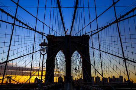 tower of Brooklyn bridge New York city at sunset photo
