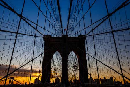 brooklyn bridge: tower of Brooklyn bridge New York city at sunset Stock Photo