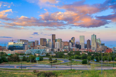 rocky road: Panorama of Denver skyline long exposure at twilight.