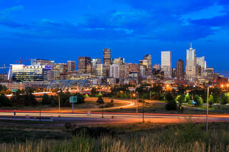 denver skyline with mountains: Panorama of Denver skyline long exposure at twilight.