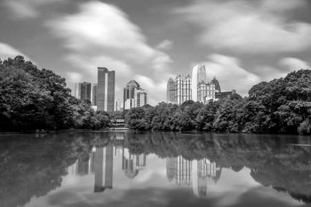 Skyline and reflections of midtown Atlanta, Georgia in Lake Meer from Piedmont Park, black, white photo