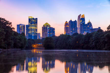 atlanta tourism: Atlanta, Georgia Skyline from Piedmont Parks Lake Meer.