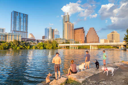 People and dogs with a view of Austin, Texas downtown skyline