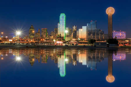 Dallas skyline reflected in Trinity River at sunset, Texas Stock Photo