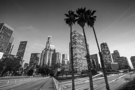 downtown: Downtown Los Angeles skyline during rush hour at sunset, black and white