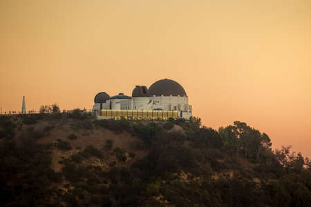 griffith: The Griffith Observatory and Los Angeles city skyline at twilight CA Editorial