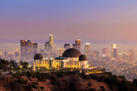 orange yellow: The Griffith Observatory and Los Angeles city skyline at twilight