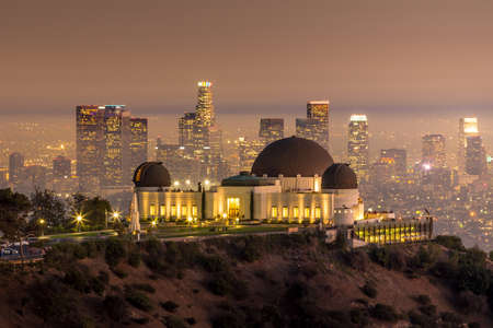 The Griffith Observatory and Los Angeles city skyline at twilight CA 報道画像