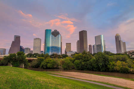 Houston, Texas  skyline at sunset twilight from park lawn
